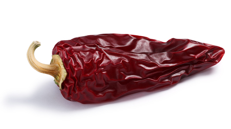 Chile seco del norte, a ripe dried Anaheim pepper. Clipping paths, shadows separated