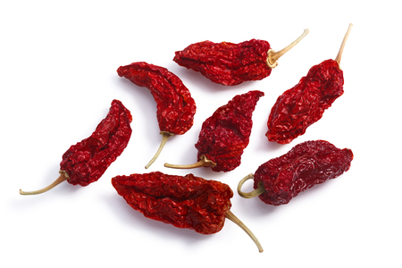 Dried Bhut Jolokia Ghost chile peppers, whole pods. Clipping paths, shadows separated, top view