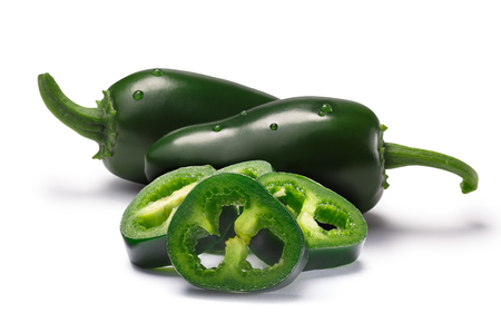 Jalapeno chile peppers sliced seedless and whole pod, immature (green). Clipping paths, shadows separated Stock Photo
