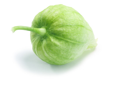 Single green Tomatillo (Physalis philadelphica) in its own husk. Clipping paths, shadow separated