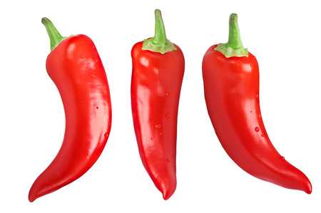 Hot Wax or Paprika chile peppers (Capsicum annuum), hanging, whole pods. Clipping paths for each pepper Stock Photo