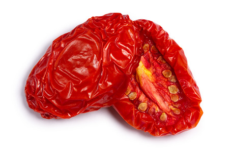 Sundried or dried tomato halves, top view. Clipping paths, shadow separated Фото со стока - 83353285