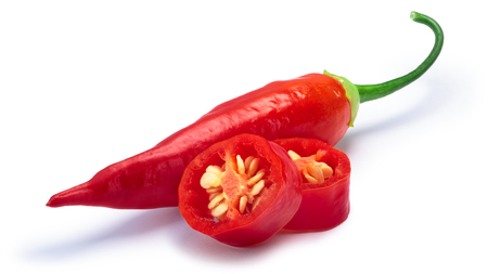 Aji Cristal pepper, whole and sliced (Capsicum baccatum). Clipping paths, shadow separated