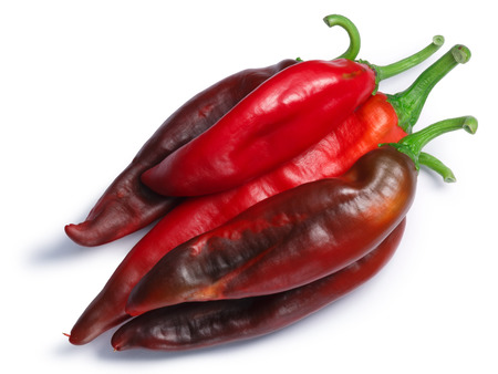 Ripe Hatch red chiles (Numex New Mexico pod type, Capsicum annuum), pile of, top view. Clipping paths, shadows separated Banco de Imagens