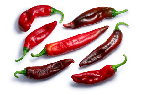 Ripe Hatch red chiles (Numex New Mexico pod type, Capsicum annuum), top view. Clipping paths, shadows separated Stock Photo