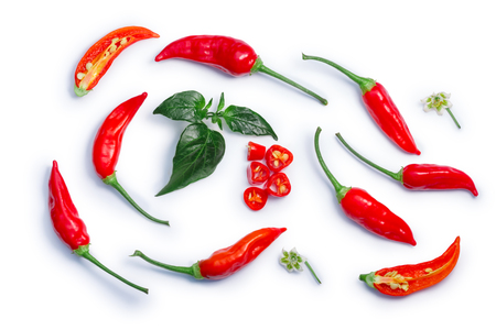 Aji Brazilian Bonanza pepper (C. baccatum), pods, diced, split, leaves, flowers. Stock Photo