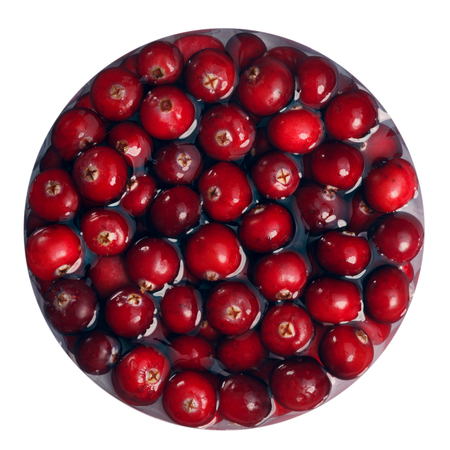 Floating immersed Cranberries, top view. Clipping path Фото со стока