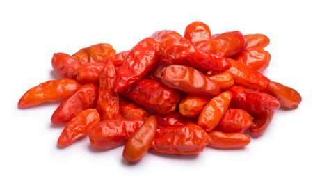 Dried chile Pequin peppers (Capsicum annuum var. glabriusculum) without stalks, pile of. Clipping paths, shadow separated