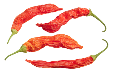 Dried Aji Wundertute peppers (Capsicum baccatum). Top view, clipping paths Stock Photo