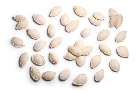 Pepita, Pumpkin seeds (Cucurbita pepo), with shells, top view. Clipping paths, shadow separated Stockfoto