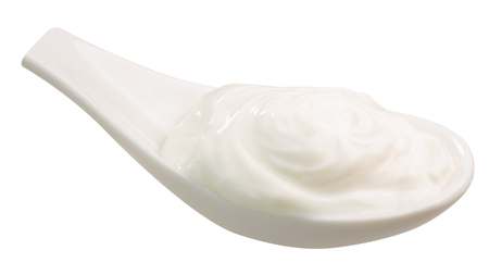 Spoonful of sour cream, yoghurt, or heavy cream. Clipping path