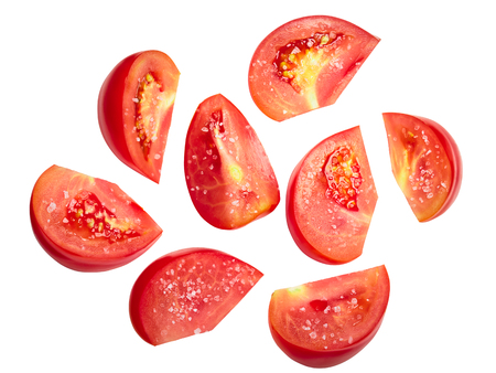 Salted tomato pieces or chunks (halved slices), top view Reklamní fotografie