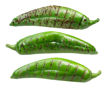 Roasted Hatch Green chile peppers (Numex New Mexico pod type) Stock Photo
