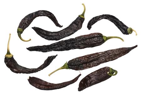 Pasilla bajio, a dried Chilaca peppers, or Chile Negro, single pods. Top view
