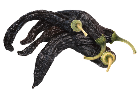 Pile of Pasilla bajio, a dried Chilaca peppers, or Chile Negro. Top view