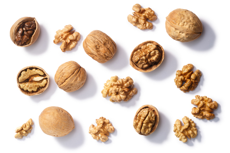 Walnuts (Juglans regia seeds), whole, shelled, halves and partially cracked, top view