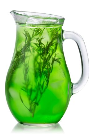 Glass pitcher of iced tarragon drink (tarkhun), isolated Zdjęcie Seryjne