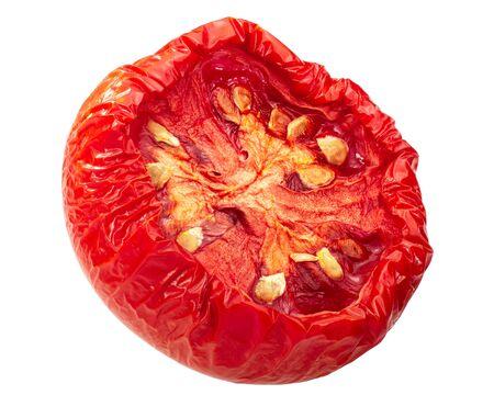 Semi-dried globe tomato half, isolated