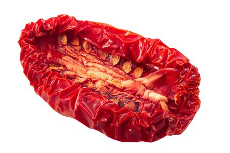 Sundried or dried plum tomato half, isolated