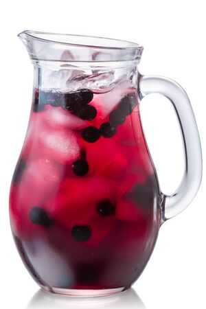 Glass pitcher of iced chokeberry (aronia) drink, isolated