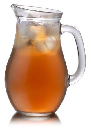 Glass pitcher of iced  Kombucha, a fermented tea mushroom drink, isolated