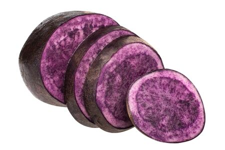 Purple potato (Solanum tuberosum), partially sliced tuber, isolated
