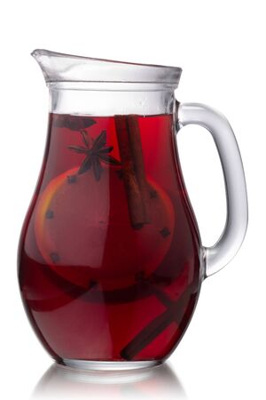 Pitcher of hot mulled wine with species, isolated