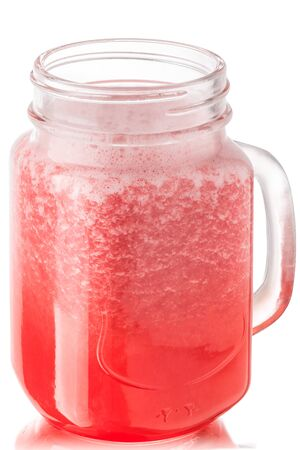 Grapefruit smoothie or freshly pressed juice in a mason jar, isolated