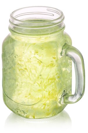Lemon lime pulp drink in a mason jar, isolated