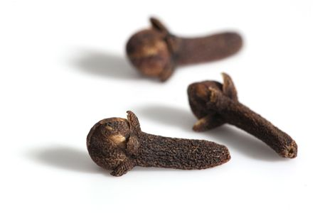 Cloves on the white background photo