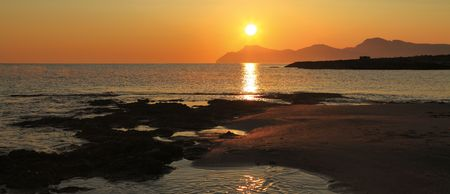Morning landscape on the bank of a bay of Alkudija, near to Can Pikafort. View on cape Ferru. Majorca Stock Photo