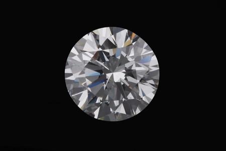 Diamond on a black background. Photo in a macroshooting mode. Stock Photo