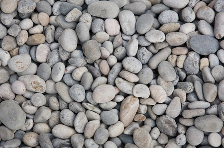 Grey river rock textured background.