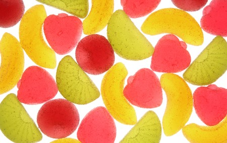 Coloured fruit candies on a white background. Stock Photo