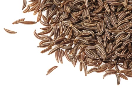 caraway: Caraway seeds on a white background Stock Photo