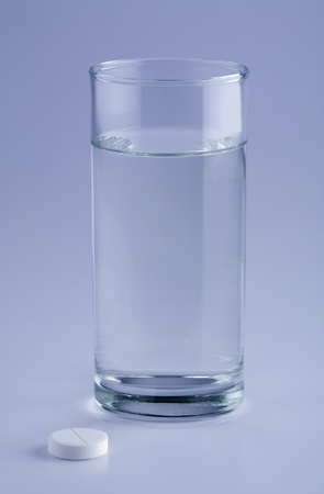 Glass of water and aspirin tablet