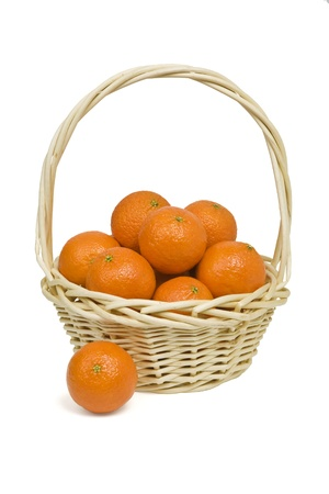Basket with tangerines on a white background.