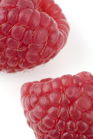 bacca: Some berries of a raspberry lie on a white background