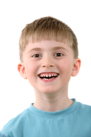 The cheerful boy on a white background