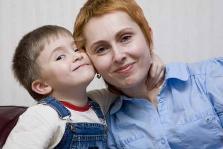 The little boy embraces mum