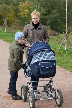 Mother with two kids walking in a park