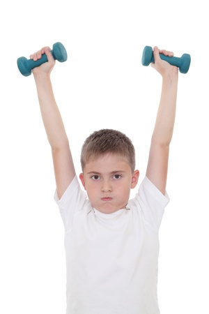 A boy doing sports with dumbbells
