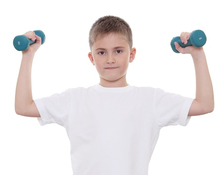 A boy doing sports with dumbbells Stock Photo - 12043423