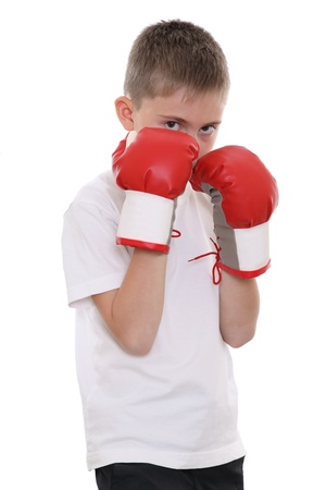 A boy in red boxing gloves ready for the fight
