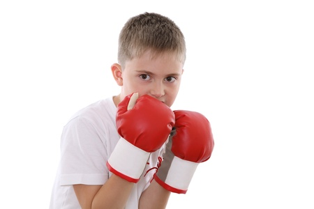 A boy in red boxing gloves in defence position photo