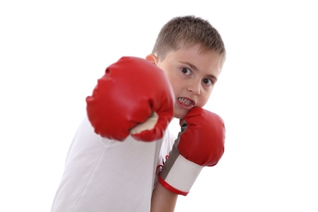 A boy in red boxing gloves in attacking position