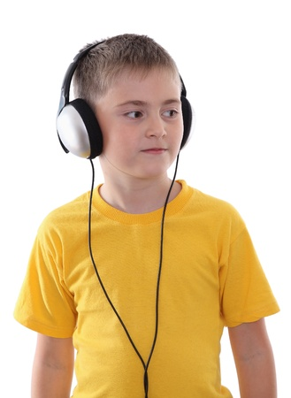 A boy listening to the music in earphones Stock Photo