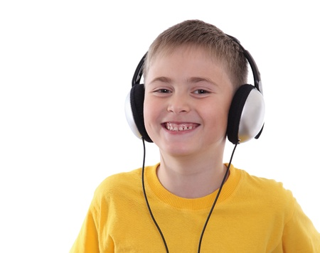 A laughing boy listening to the music in earphones Stock Photo