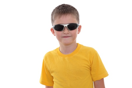 A smiling boy in sunglasses