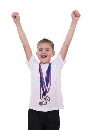 A smiling boy shouting hurray after victory in compeition